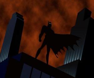 Puzzle Batman, l'homme chauve-souris, en rsurveillant la ville du toit d'un bâtiment à Gotham City
