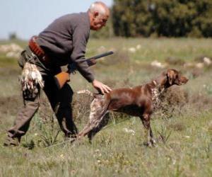 Puzzle Chasseur avec son chien de chasse