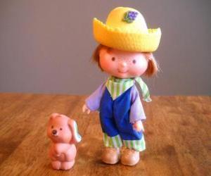 Puzzle Clafoutis Myrtilles  ou Petit Beignet  jouant avec son animal, le chien Cornet pistache ou Grignotine. Il est l'un des amis de Charlotte aux fraises