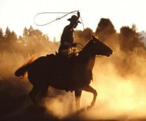 Puzzle Cowboy en montant un cheval avec le lasso