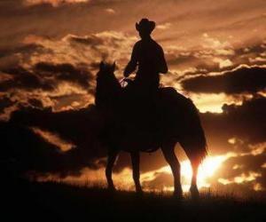 Puzzle Cowboy montant un cheval ou à la tombée de la nuit