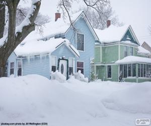 Puzzle Deux maisons couvertes de neige