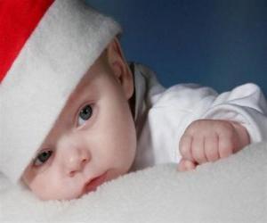 Puzzle Enfant avec un chapeau de Père Noël