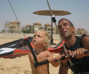 Puzzle Enfant faisant voler un cerf-volant avec son père