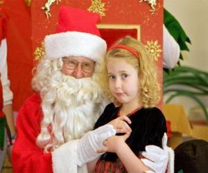 Puzzle Fille en parlant au Père Noël assis sur son genoux