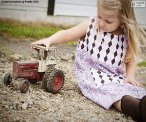 Puzzle Fille jouant avec un tracteur