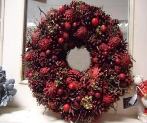 Puzzle guirlande de Noël avec des fruits rouges