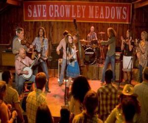 Puzzle Hannah Montana (Miley Cyrus) à accomplir une de ses chansons dans les coins Crowley, la ville qui a donné naissance à Miley.