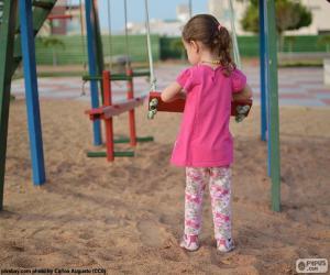 Puzzle Jeune fille sur une balançoire