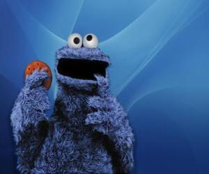 Puzzle Le montre dévoreur de gâteaux est de manger un cookie