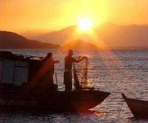 Puzzle Les pêcheurs au coucher du soleil
