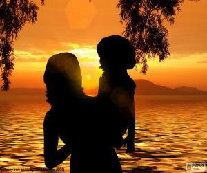 Puzzle Mère avec son fils dans ses bras