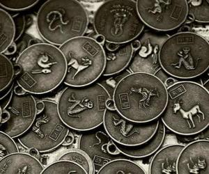 Puzzle Médailles avec les signes du zodiaque chinois
