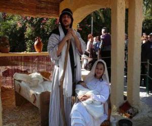 Puzzle Marie, Joseph et l'enfant Jésus dans la crèche vivante