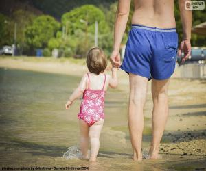 Puzzle Père et fille sur la plage