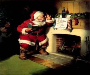 Puzzle Pére Noël lecture d'une note suspendues de le foyer