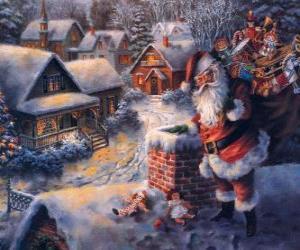 Puzzle Père Noël sur le toit d'une maison à côté d'une cheminée