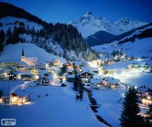 Puzzle Petite ville complètement neigé la veille de Noël