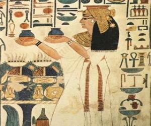 Puzzle Pierre égyptien gravée de la représentation d'une déesse avec des inscriptions ou des hiéroglyphes