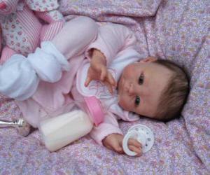 Puzzle Près de baby-doll réel