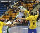Handball - Joueur dans un saut pour lancer