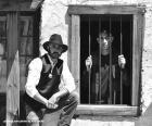 Ancien shérif avec un chapeau de cow-boy et son étoile sur la poitrine