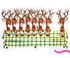 Groupe de rennes de Noël d'attente pour l'alimentation