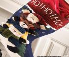 Chaussette de Noël avec des ornements et des cadeaux