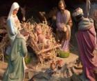 La Sainte Famille dans l'étable avec le boeuf et le mulet, un berger avec un mouton et un roi de leur donner des cadeaux à Jésus