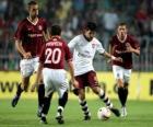 L'action d'un match de football dans le stade