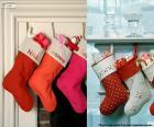 Plusieurs suspendus bas de Noël rempli de cadeaux