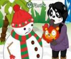 Bonhomme de neige sans nez pompon comme il veut manger à la surprise de Penny