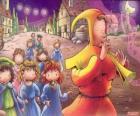 Le joueur de flûte de Hamelin mystérieusement avec tous les enfants du peuple derrière le son de la flûte