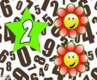 Nombre 2 dans une étoile avec deux fleurs