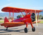 Avion biplan rouge