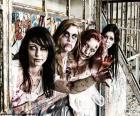 Quatre jeunes filles déguisées en zombie pour célébrer la fête de l'Halloween