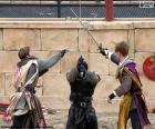 Trois chevaliers combattant