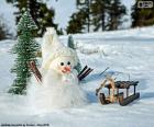 Bonhomme de neige et traîneau