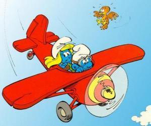 Puzzle Schtroumpf et Schtroumpfette un pilotage d'un avion rouge