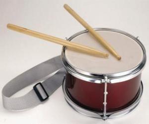 Puzzle Un tambour, avec une paire de baguettes